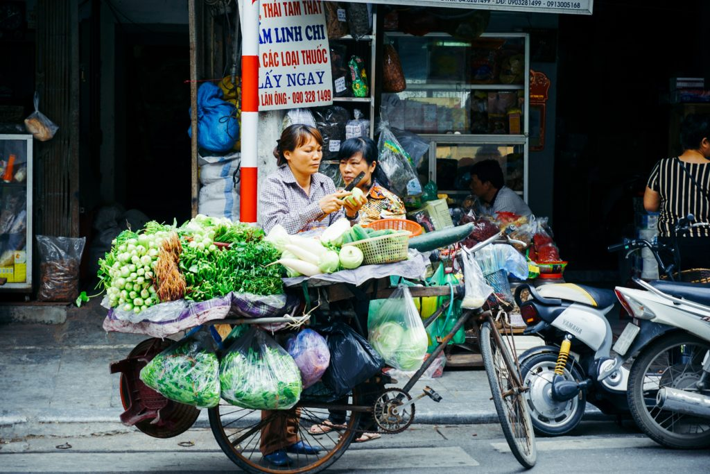 A Vietnamese woman selling produce from her mobile store.