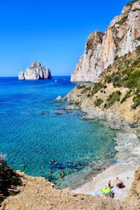 Beautiful warm beach in Sardinia Italy. Italian beach. Travel during Covid-19
